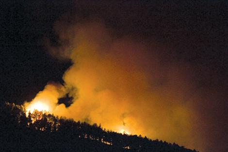 Flames climb a ridge in the Irvine Flats area Aug. 13.