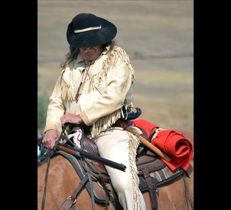 Don Clauson, assistant fire chief for Rollins Volunteer Fire Department, dressed in buckskin and rode his horse through the parade route.