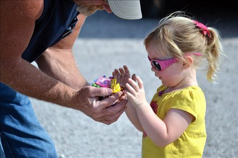 Taryn Veach surveys her load of candy scooped up at the Dayton Daze parade.