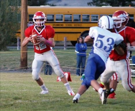 Warriors' quarterback Riley Rogers looks for an open receiver.